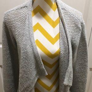 Volcom  since nineteen ninety one sweater wrap.